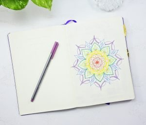 a colorful mandala on the first page of a bullet journal