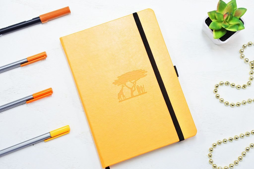 dingbats earth collection dot grid notebook in yellow