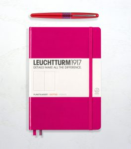Leuchtturm 1917 in berry and a Pilot Metropolitan fountain pen in red.