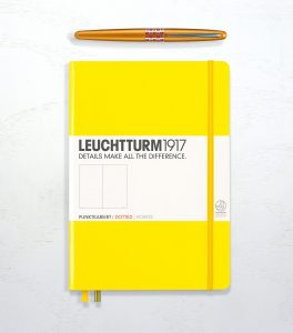 Leuchtturm 1917 in lemon yellow, dotted, and a Pilot Metropolitan in orange.