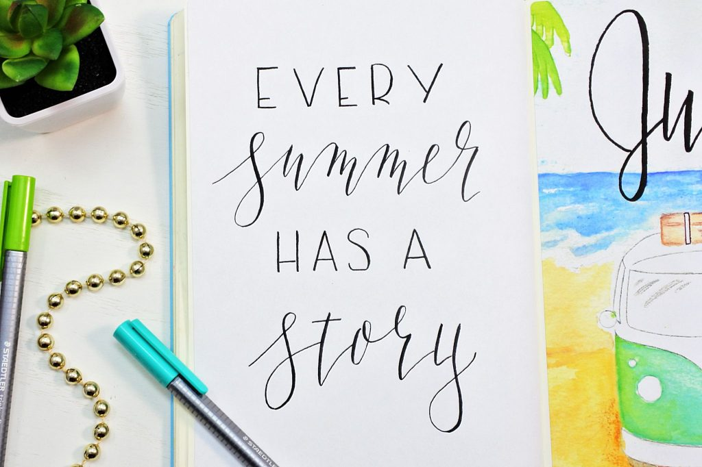 Hand lettered summer quote in a bullet journal.